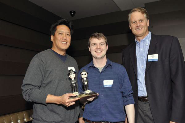 John Donahoe and Glenn Lim Present Andrew Angell with an eBay Live! 2008 Star Developer Award.